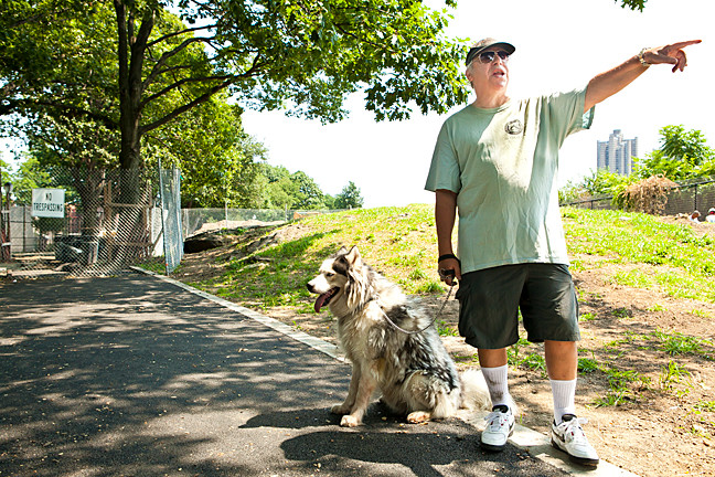 Philip Spivack, 66 walks his Siberian Husky Callahan, 5, toward the closed area where they had acess to the dog run at Ft. Independence Park.