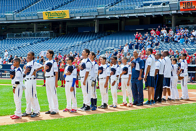 Uptown Sports Knights stand for the National Anthem at Yankee Stadium prior to their game against the Rebels on August 14.