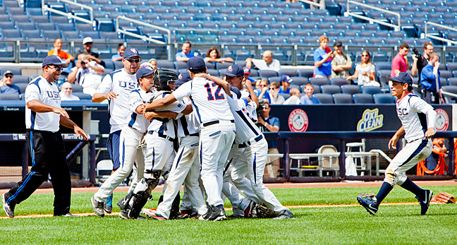 The Knights huddle in celebration of their victory over the Rebels at Yankee Stadium on Aug. 14.