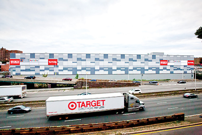 Photo editor Marisol Díaz captured the moment as a Target truck sped along the Maj. Deegan Expressway past the new Broadway Plaza mall last Friday evening.