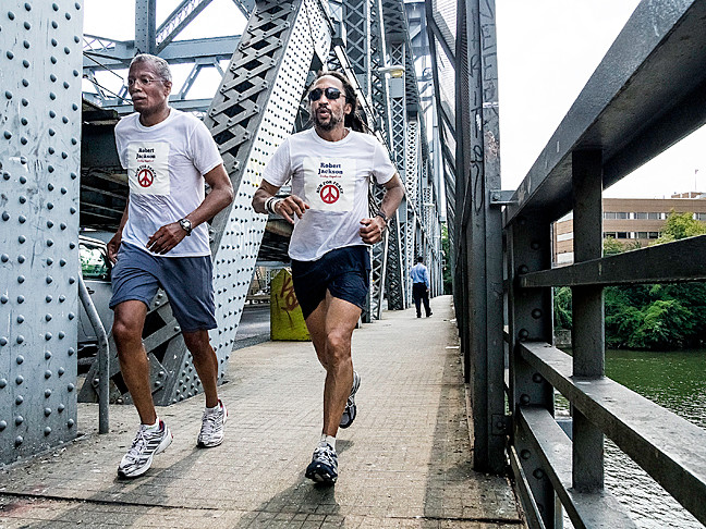 State Senate Candidate Robert Jackson, left, is literally running for office across the Broadway Bridge to a Marble Hill campaign stop.