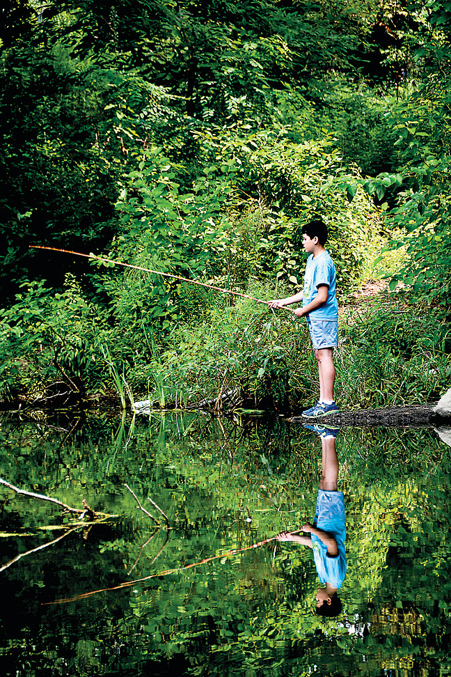 Justin Sanchez,12, waits in anticipation for a fish  while participating in Van Cortlandt Park's fishing program on August 17.