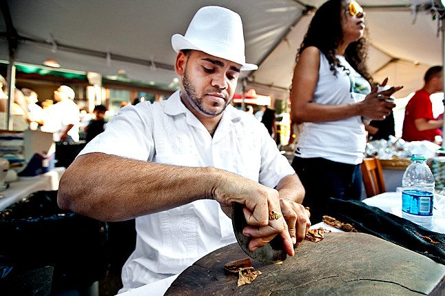 Melvin López, 31, of ND Cigars, Inc., rolls an appealing smoke.