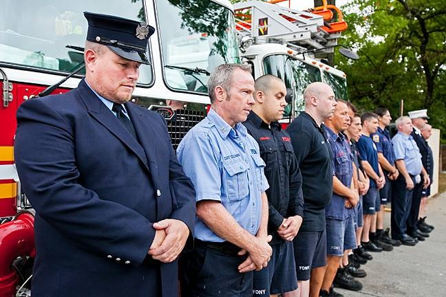 Firefighters gather at the station on Henry Hudson Parkway to observe moments of silence for major events on Sept. 11, 2001 including the destruction of the World Trade Center, the attack on the Pentagon and the airplane crash in Pennsylvania. From left are Firefighter Watson, Ladder 52, Captain Coleman, Engine 52, Firefighter Fernandez, Engine 52, Firefighter Curtain, Engine 52, Firefighter Ruggerillo, Engine 52, Firefighter Moen, Ladder 37, Firefighter DePalma, Engine 62, Firefighter DeJesu, Ladder 37, Firefighter Petrich, Ladder 52, Firefighter Giordano, Ladder 52, Lieutenant Encke, Ladder 52, Captain Keating, Ladder 52 and Firefighter McNichol, Engine 52.