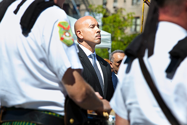 Borough President Ruben Diaz Jr. stands at attention during a moment of silence.