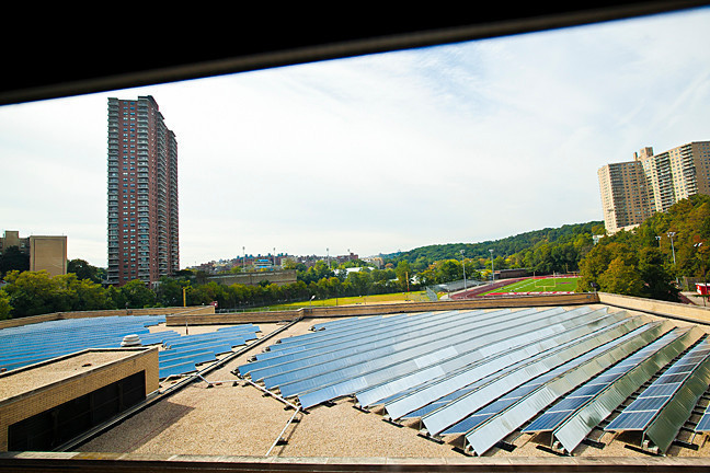 An array of photovoltaic panels on John F. Kennedy Educational Campus' rooftop is expected to provide 5 percent of the building's electricity.