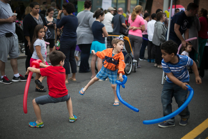 Devin Cuddy, 4, gets in a fighting stance as he play battles Rami Lapin and Isacc Veras, both 5, in a ballon sword fight at the annual Jonson Venue Block party on Sunday.