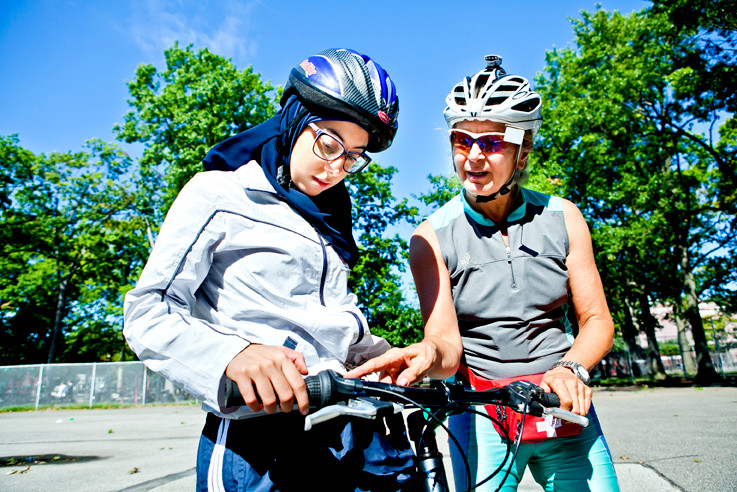 Susan Rodetis, 63, right, a certified instructor, teaches Asmaa Abbas, 22, how to use the gearshift on her bike at the Bike New York Street Skill Ride at the Van Cortlandt Park Southwest Playground last month. For information on upcoming activities, go to www.bikenewyork. org.