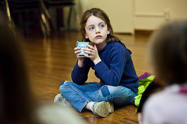 Roma McHugh, 7, holds the Tzedakah during the Congregation Tehillah Hebrew class at The Riverdale Yonkers Ethical Culture on Nov. 5.