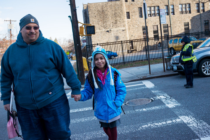 Michael And Gissele Garcia leave the St. Margaret of Cortona School on Riverdale Avenue at the end of the first day back to school after winter break on Monday.