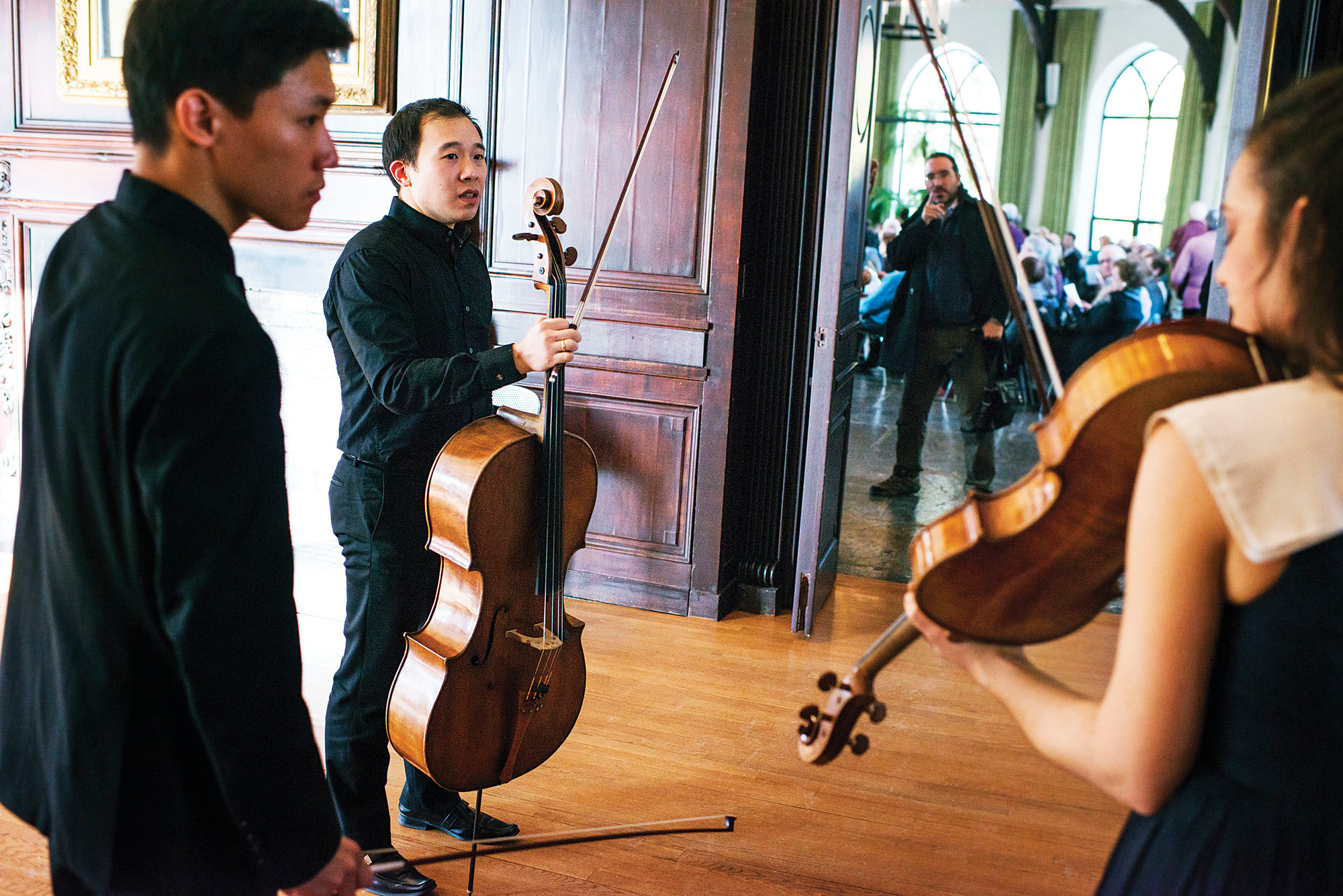 Violinist Daniel Chong, cellist Kee-Hyun Kim, and violist Jessica Bodner wait to enter the concert hall at the Wave HIll estate, before a classical performance by their group, the Parker Quartet, on Jan. 11, 2015.
