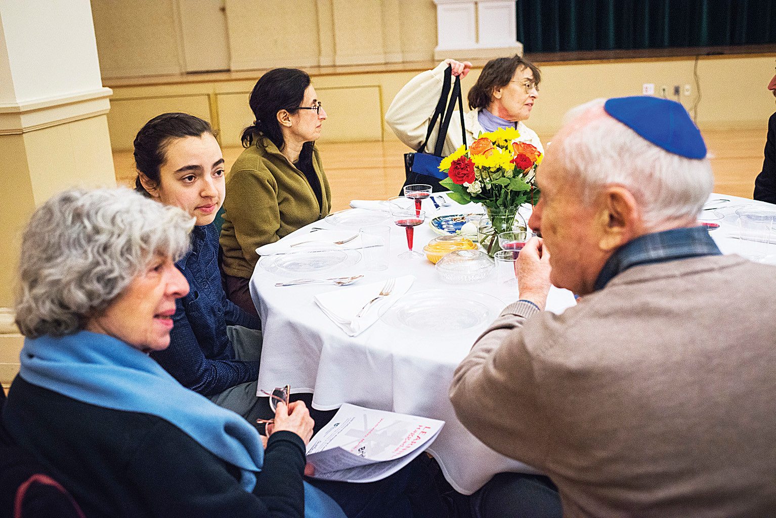 Seder attendees trade stories while at the Manhattan College celebration.