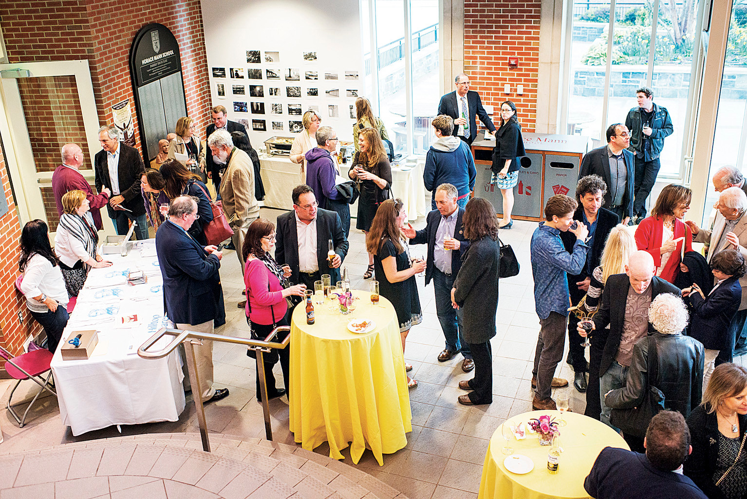 Guests enjoy cocktails and hors d'oeuvres at Horace Mann before a charity jazz concert by the Hilltop Cares.