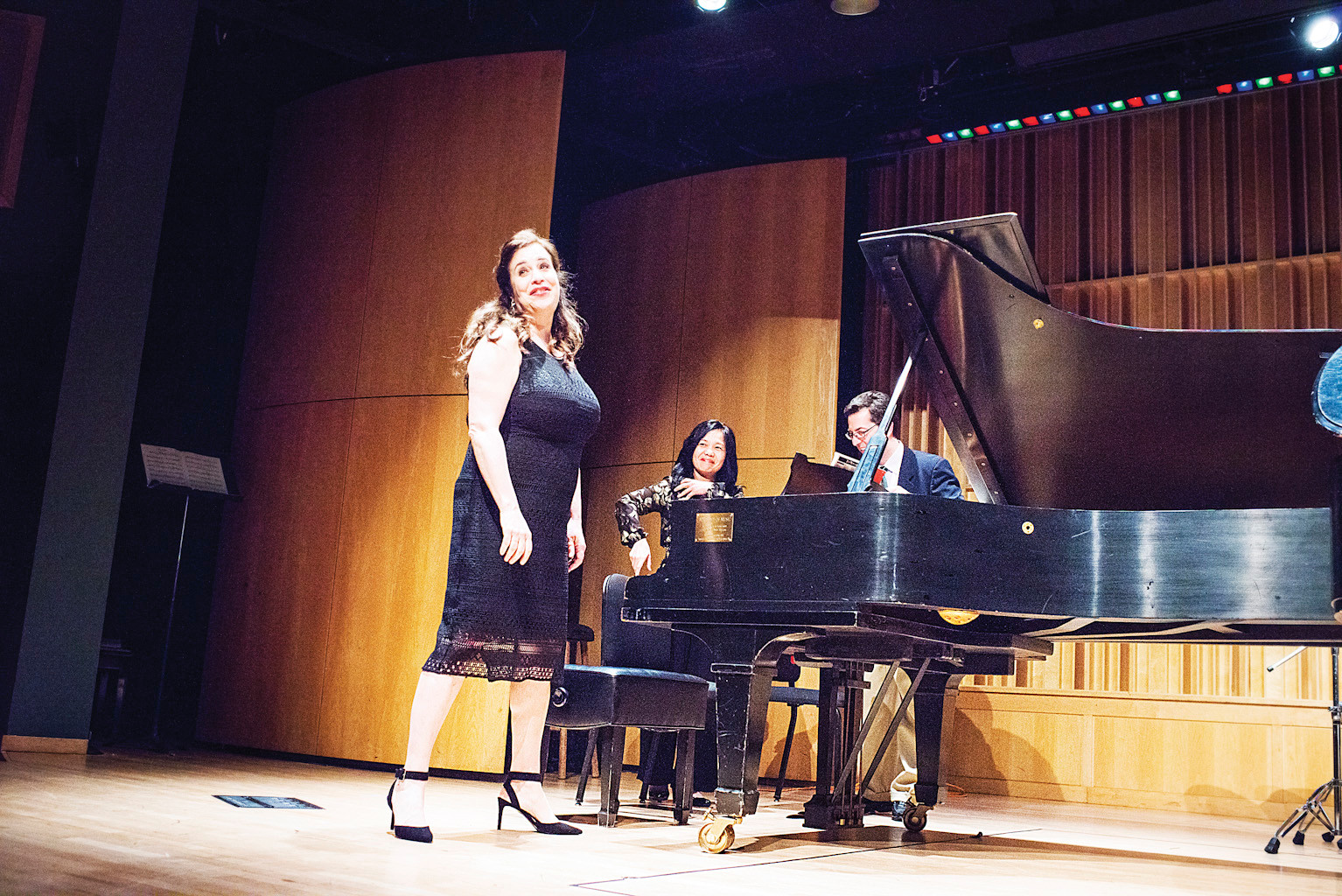 Pianist Claudia Knafo, a Horace Mann graduate, performs in the school's auditorium during a Hilltop Cares charity event supporting victims of sexual abuse at the school, on April 30.