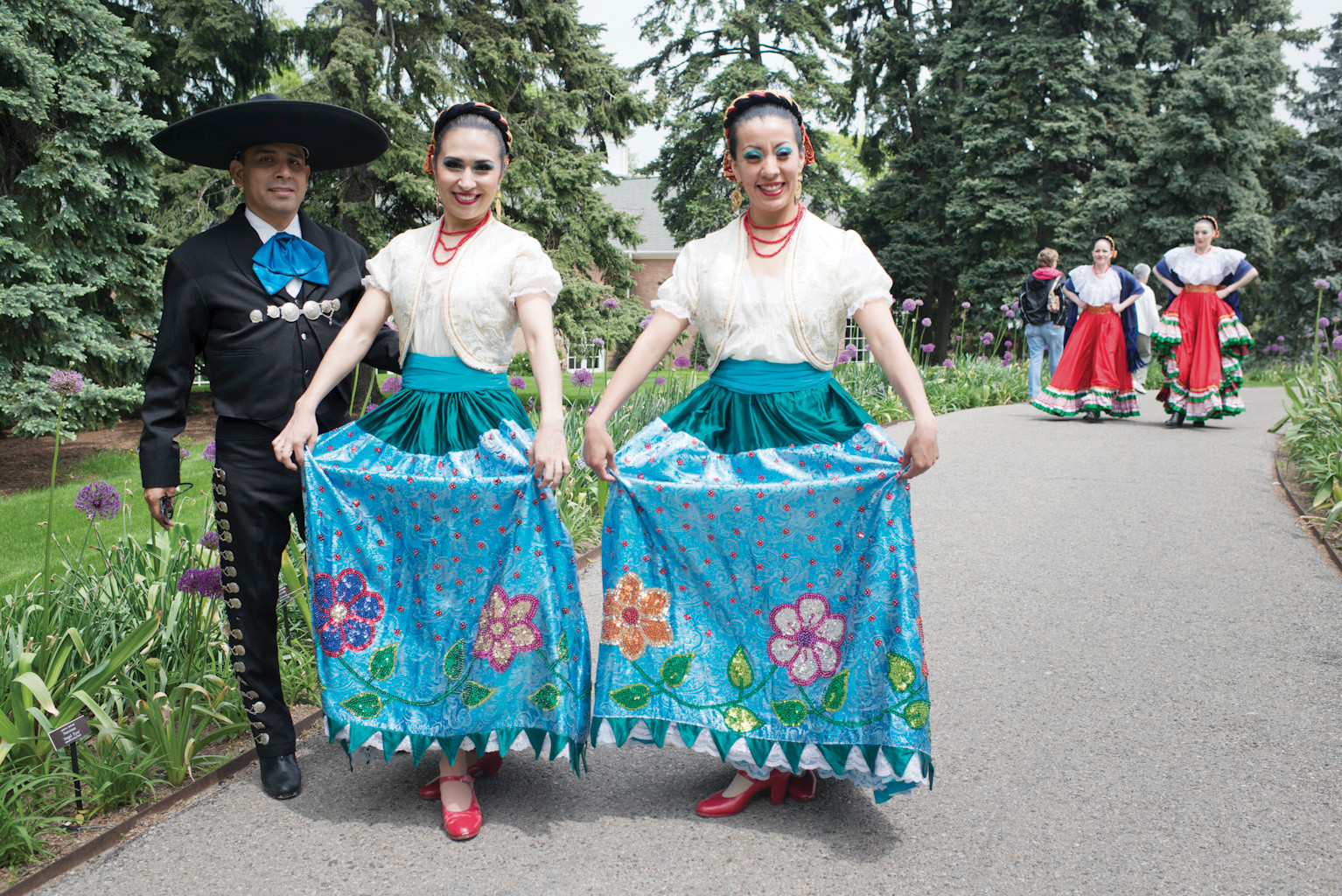 Members of the Calpulli Mexican Dance Company, based in Elmhurst, pose for a photo before running off to a performance during the 'Frida Kahlo: Art, Garden, Life' exhibit which opened for members on May 15.