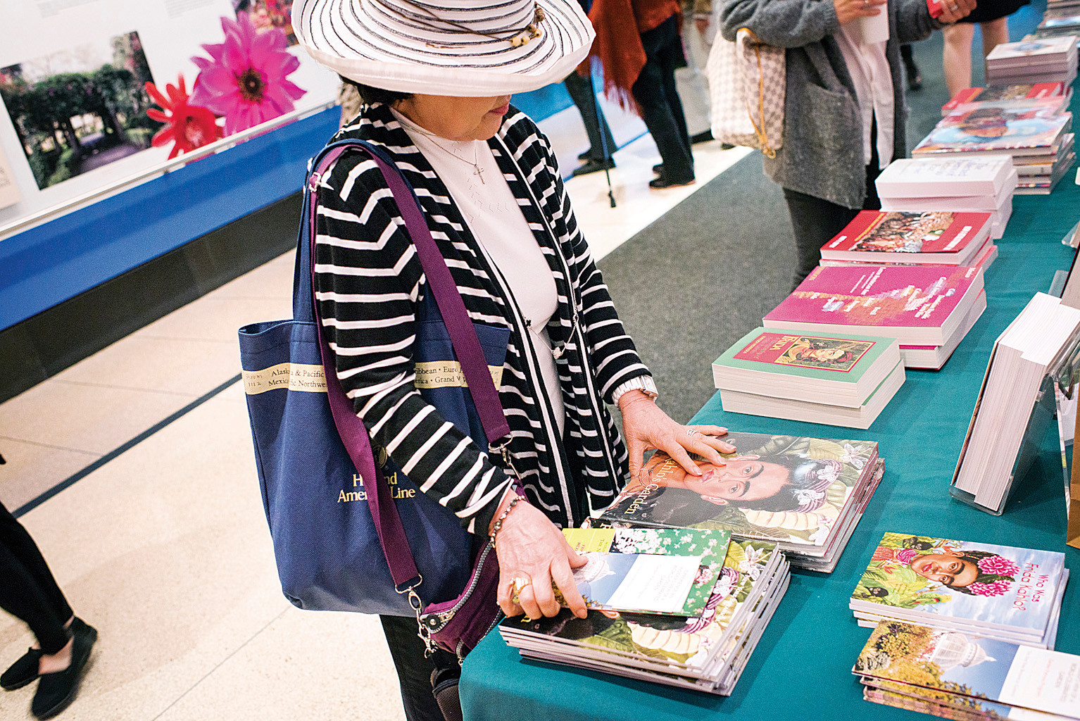 New York Botanical Garden members view the Frida Kahlo books for sale before a panel discussion on Mexican Art in the Ross Auditorium.
