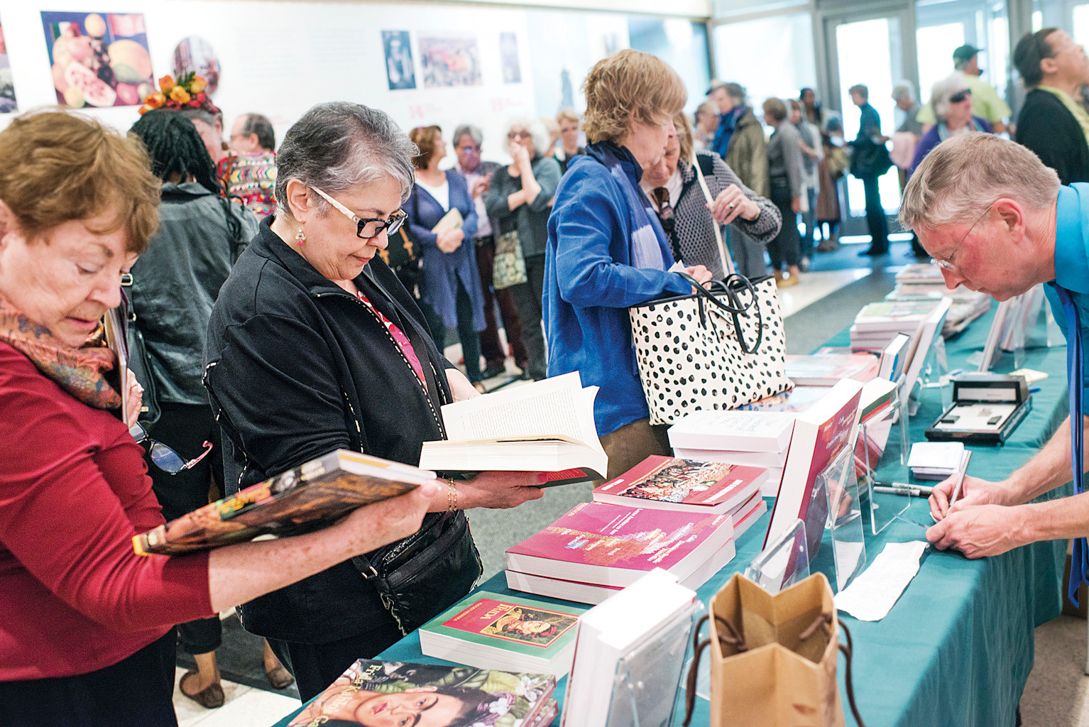 Members view the Frida Kahlo books for sale before a panel discussion on Mexican Art in the Ross Auditorium.