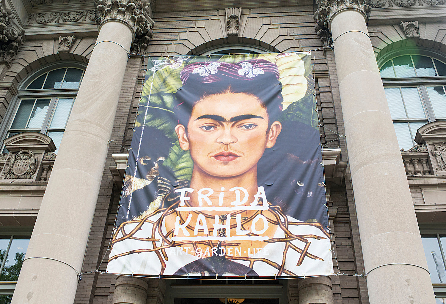 A large Frida Kahlo print hangs over the Britton Rotunda entrance.