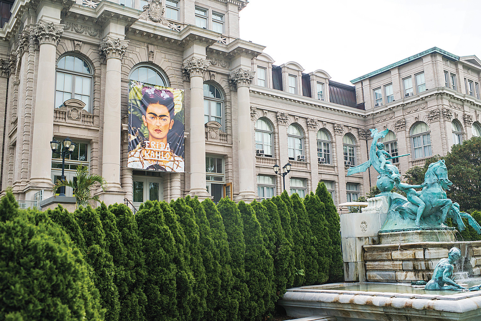 A large Frida Kahlo print hangs from the Britton Rotunda entrance.