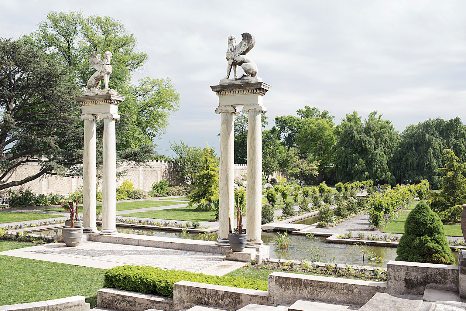 Greco-Roman columns overlook the reflecting pools in the Walled Gardens at Untermyer Park.