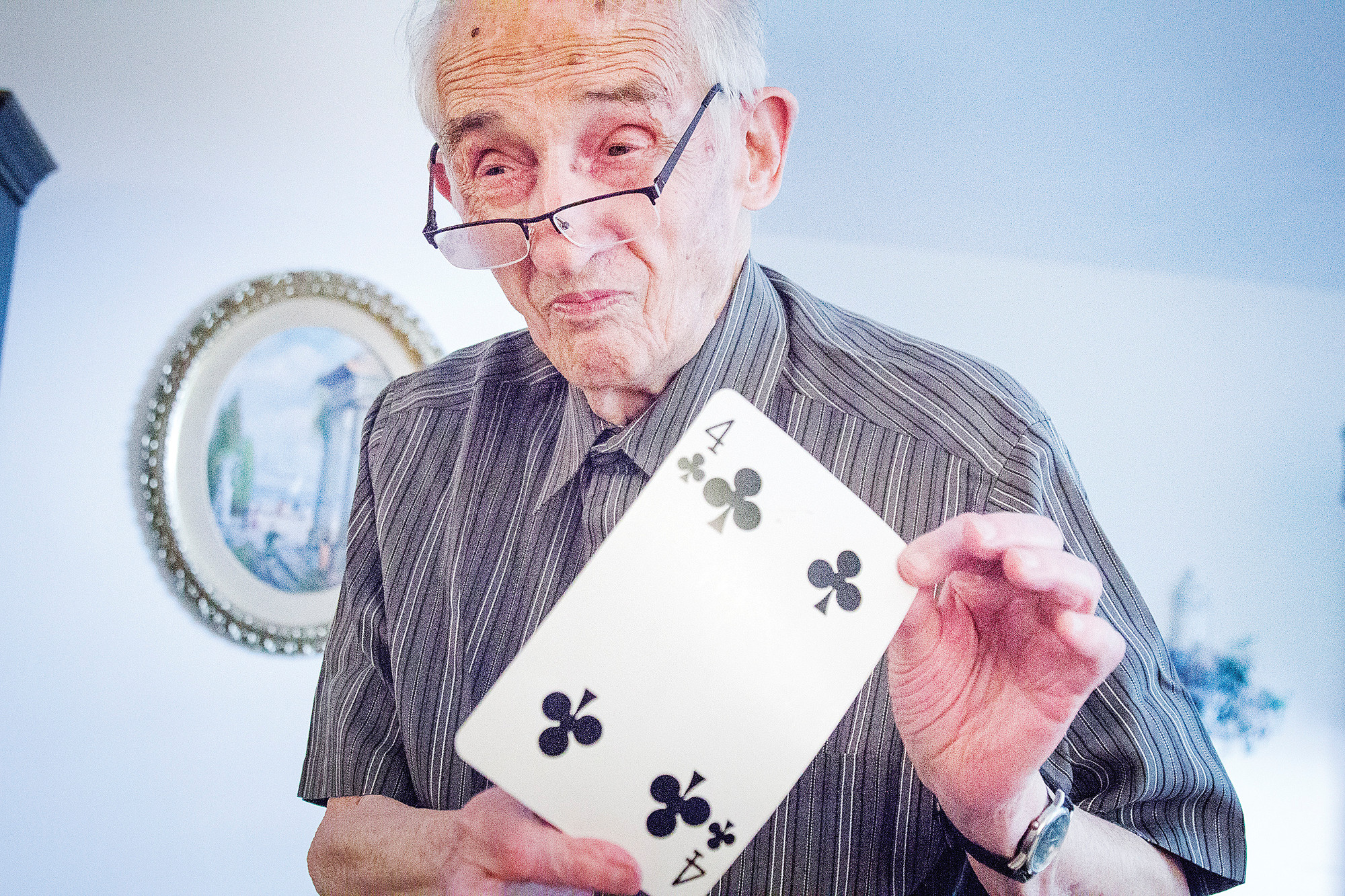 Jerry Oppenheimer, 93, the Society of American Magicians' Magician of the Year, demonstrates one of his card tricks at his home on June 19.