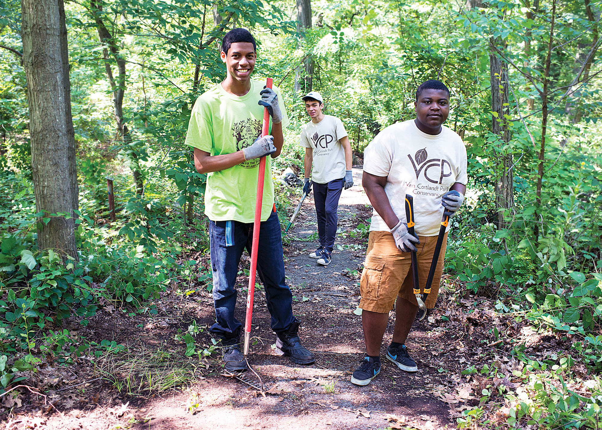 Steven Francis, Marcus Anderson, and Curtis Antiwi pose for a photo together as they clear overgrown trails in Van Cortlandt Park on July 16.