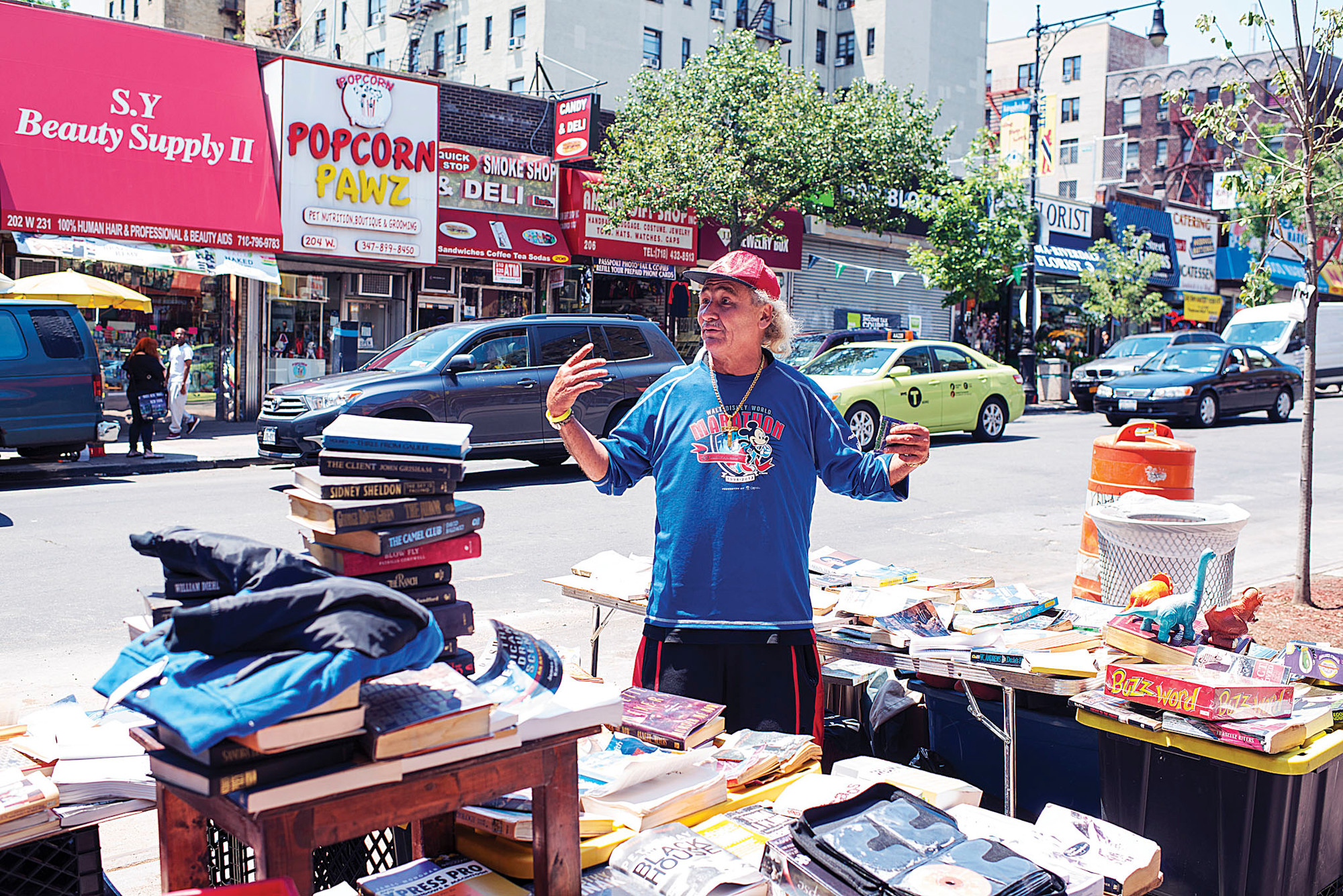 Vendor Peter Diego, 49, next to his book stand on West 231st Street.