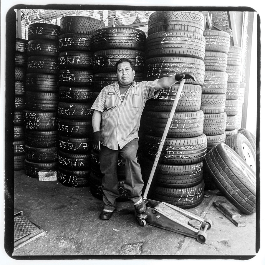 Josè Cruz, a mechanic at Diffo Auto Glass & Flat Fix, 1510 Jerome Avenue. Josè has been working on Jerome Avenue for 25 years--he fled the civil war in his native El Salvador in 1990.