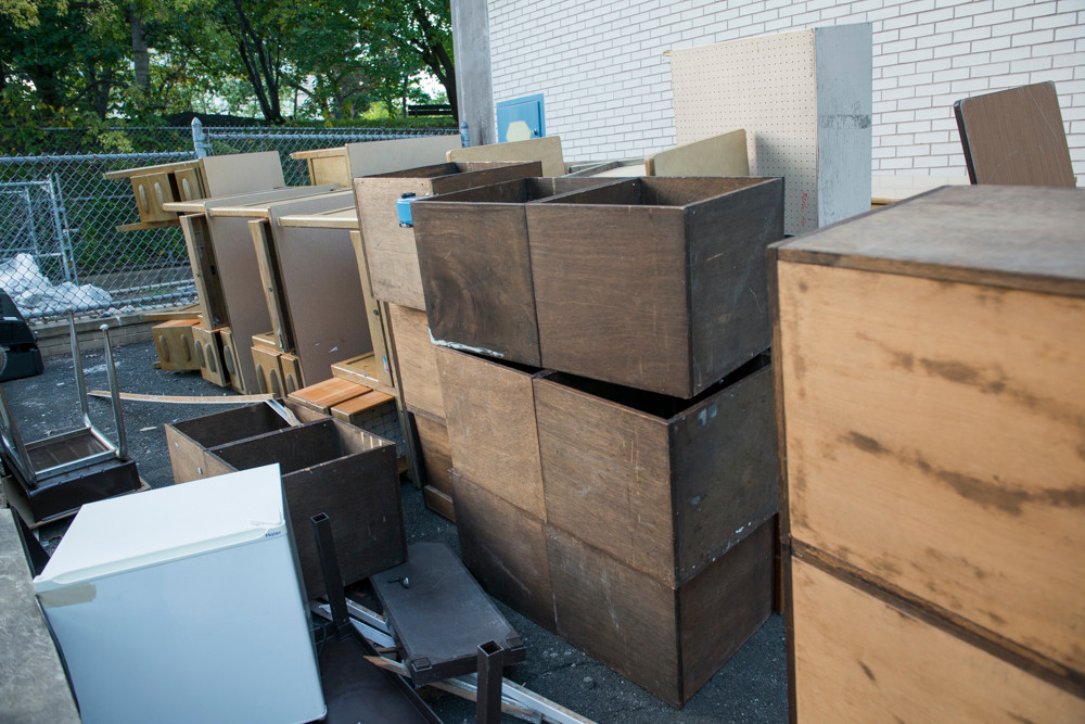 Teachers' desks from the Spuyten Duyvil School (P.S. 24) stacked in a recycling area by the school on Oct. 15. All of the desks have since been returned.