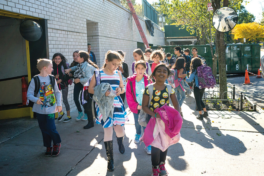 Students from The Spuyten Duyvil School (P.S. 24) leave the Annex in the Whitehall co-op on Monday afternoon, as parents fear they will soon be evicted.