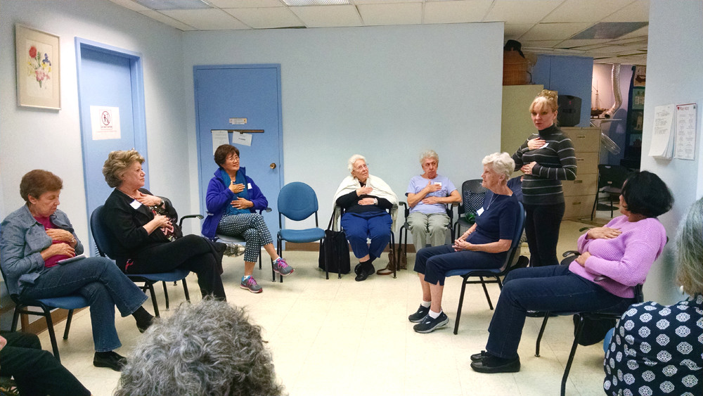 The scene recently at the Riverdale Senior Services women's circle, as Reiki Master Karen Frances McCarthy guides the residents through the practice.