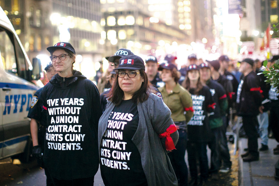 Protesters gathered in front of CUNY's midtown headquarters on Nov. 4 to advocate for a new union contract.