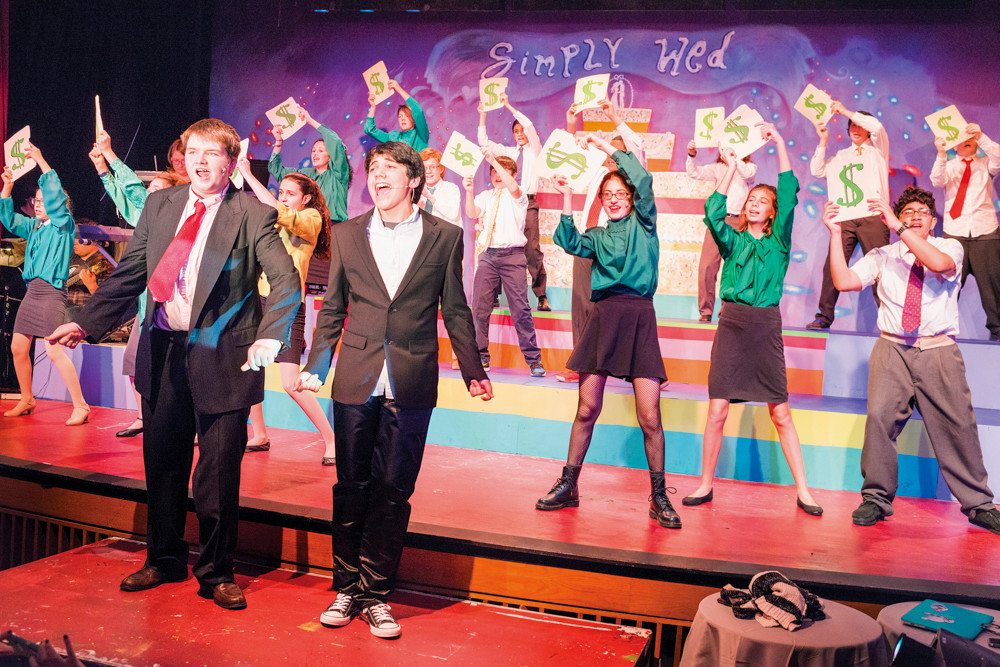 Trevor Scott and Yanniv Frank perform with the rest of the cast in the Riverdale Rising Stars' production of 'The Wedding Singer' during a dress rehearsal on Dec. 3.