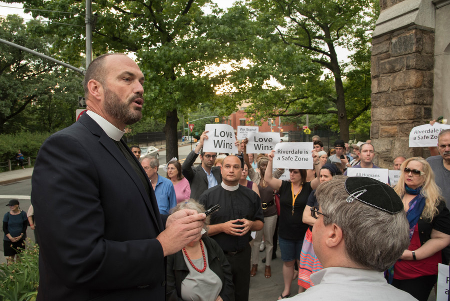 Rev. Andrew Butler of Christ Church Riverdale urges passage of stricter gun control laws at a June 15 vigil for victims of the Orlando attack at Riverdale Monument