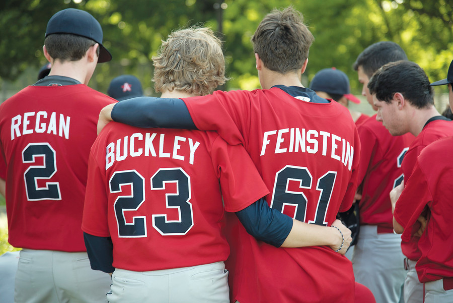 Jack Buckley and Jakob Feinstein console each other after a 0-4 title defeat against East Side Community Tigers on June 1.