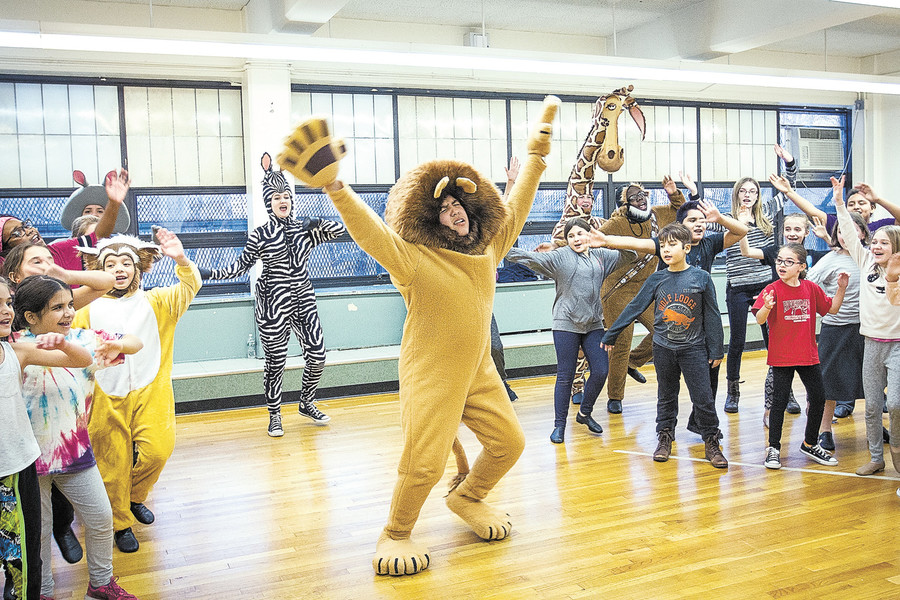 Daniel Mejil, 14, as Alex the lion with the cast of the Riverdale Children's Theater during a Jan. 10 rehearsal of 'Madagascar' at the David A. Stein Riverdale-Kingsbridge Academy.