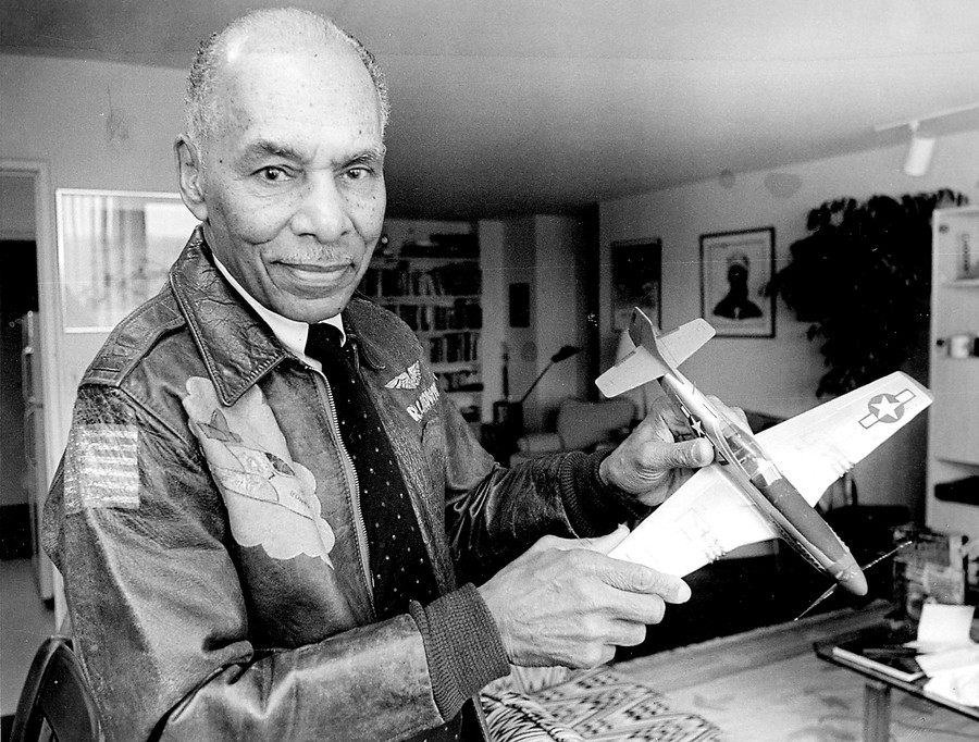 Roscoe Brown, the World War II pilot and Bronx educator, pictured in his Riverdale home in 1995 with a model of his fighter plane.