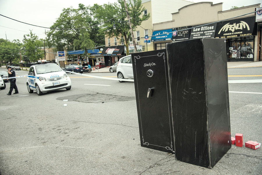 A huge safe sits on Riverdale Avenue after thieves carried it out of a Verizon Wireless store in a June burglary.