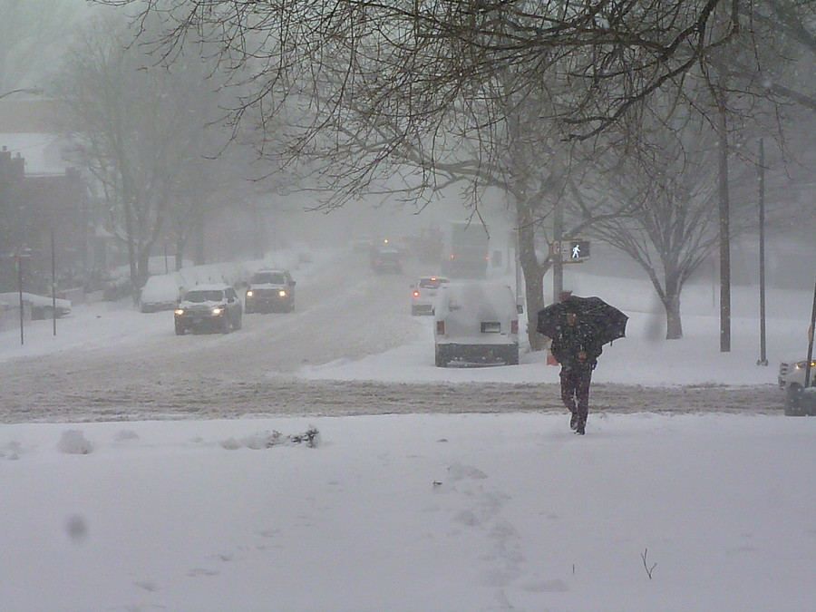 A man walking with an umbrella on Thursday morning, as a snowstorm hit Riverdale.