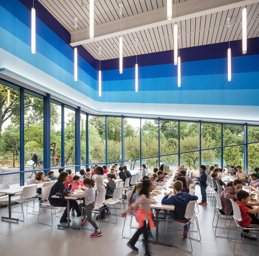 Students enjoy a meal in the new cafeteria, which also doubles as the student center.