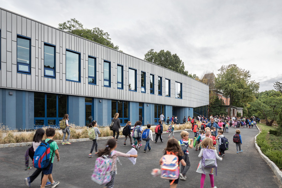 Children head toward the Riverdale Country School's new Lower School building that opened its doors at the start of the 2016-2017 school year. 