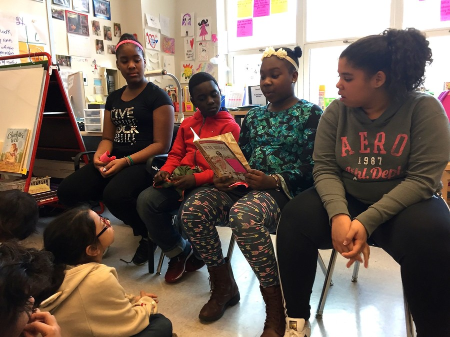 "Fifth-graders at AmPark read the book ""The Story of Ruby Bridges"" to third-grade students as part of the school's Black History Month celebration."