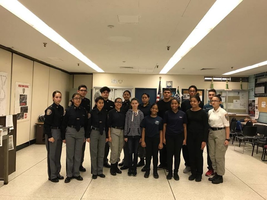 Participants in the 50th precinct's Police Explorers program, which offers young people a chance to learn about what it takes to be a police officer, pose for a camera at a recent meeting.