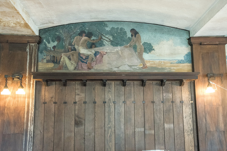 The Ecology Building at Wave Hill was once a playhouse for the Perkins family's children. A vast mural with scenes from Native American life graces the walls.