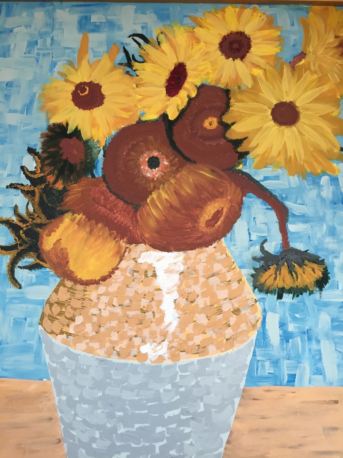 Alexander Acevedo sought to re-create Vincent Van Gough's 'Sunflowers' painting for his mural. He also painted another mural , inspired by ancient pottery.