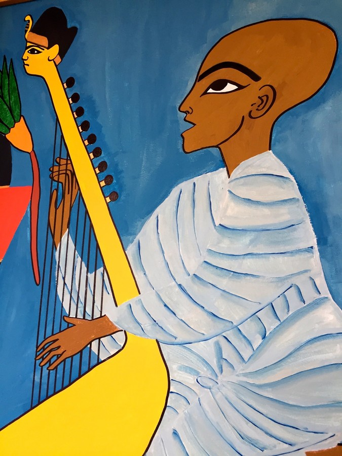 This mural, by Mariyam Mohammed, was inspired by Egyptian art. 