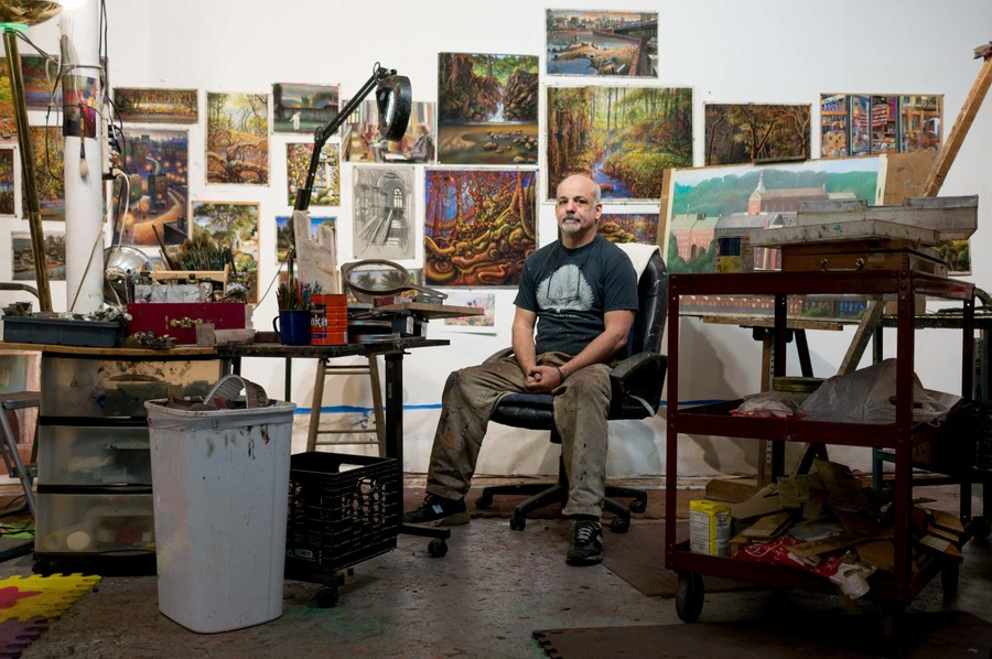 Daniel Hauben is surrounded by works in progress in the Riverdale studio where he is as likely to create a rural landscape as a gritty Bronx scene.