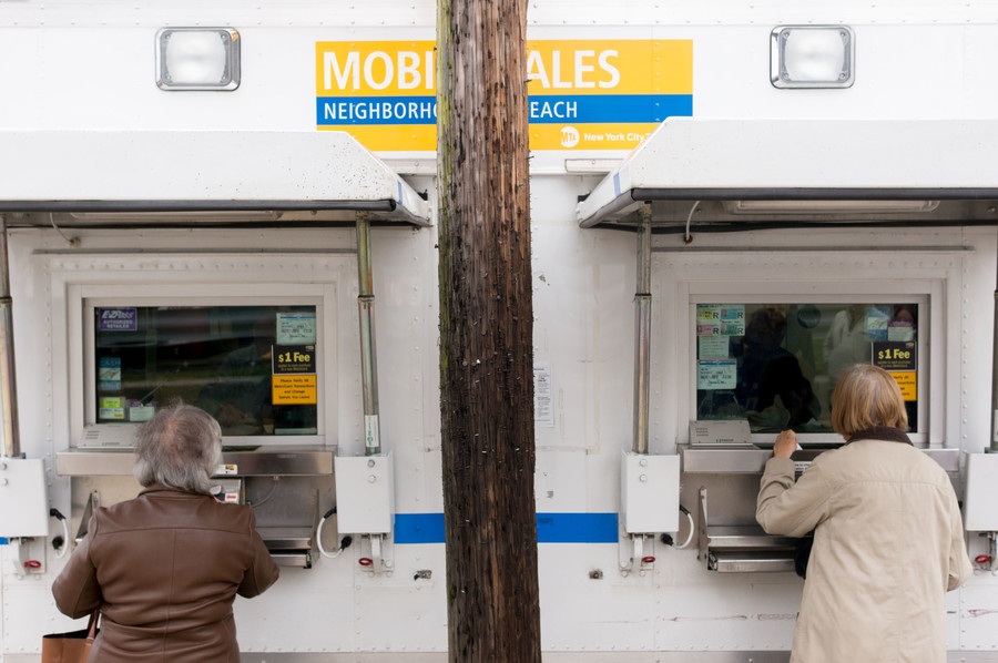 Residents in north Riverdale purchase MetroCards.