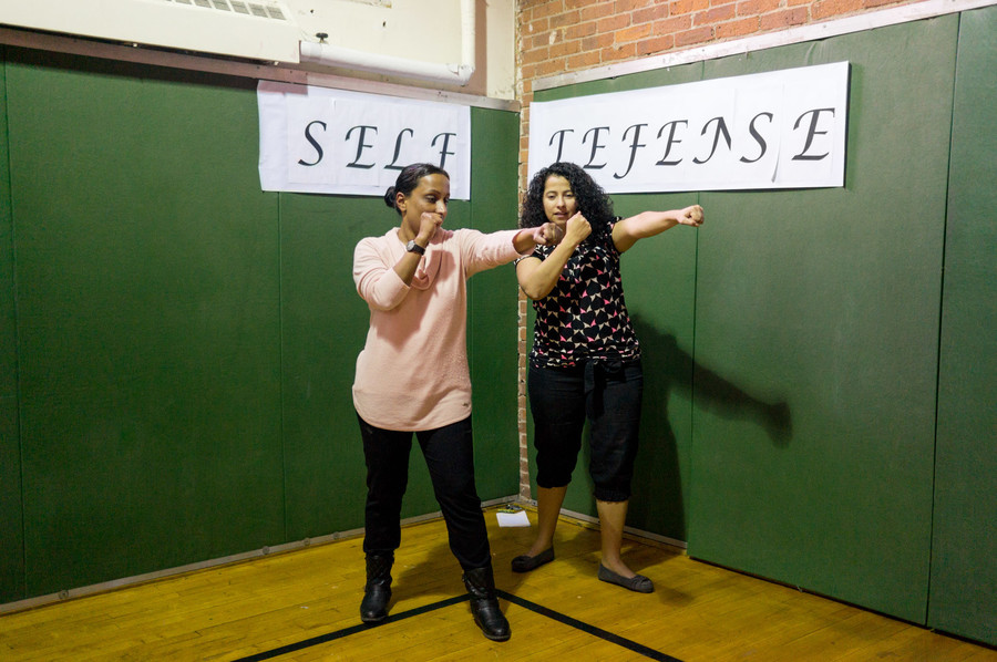 Aditi, left, teaches self-defense techniques at the Kingsbridge Heights Community Center. It is part of an afternoon of events honoring sexual assault survivors.