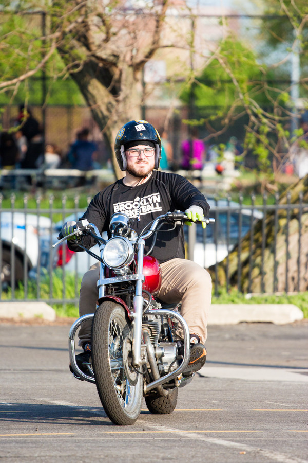 Press reporter Anthony Capote rides a Honda Rebel at the end of his introductory lesson at Motorcycle Safety School, which offers classes in the north parking lot of Lehman College.